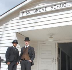 Mr. Booker T. Washington (left), portrayed by Shaban Ghaffur and Mr. Julius Rosenwald, portrayed by Bryan Lee, welcome guests into the Pine Grove School.- Photos by Lisa Smarr